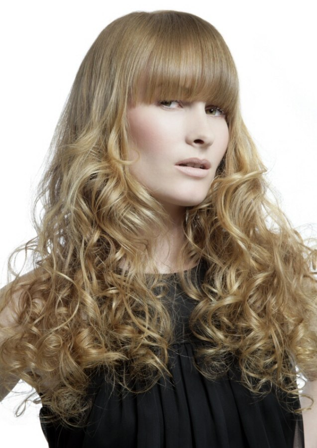 Long Hairstyle With Blonde Spirals And Bangs That Are Half