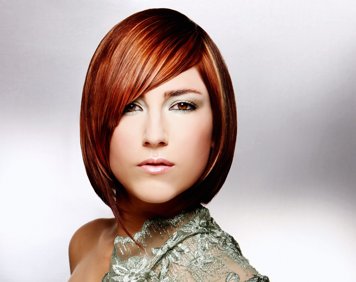 Chin Length Bob Hairstyle With The Fringe Falling In A Curve Across The Face