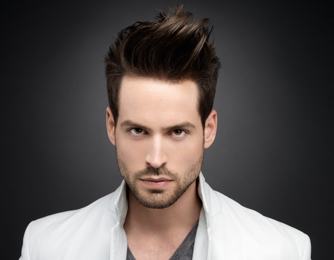 Guy with his hair cut around the ears and styled with gel