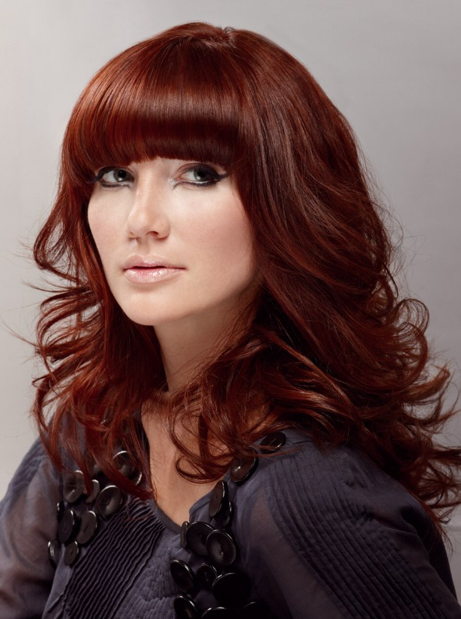 Long Layered Red Hair With Curls And A Low Above The Eyes