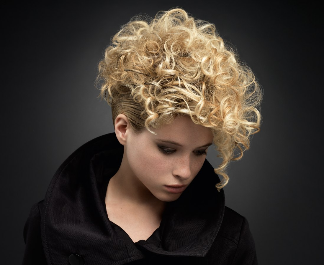Short Blonde Hairstyle With Curls That Cover The Forehead