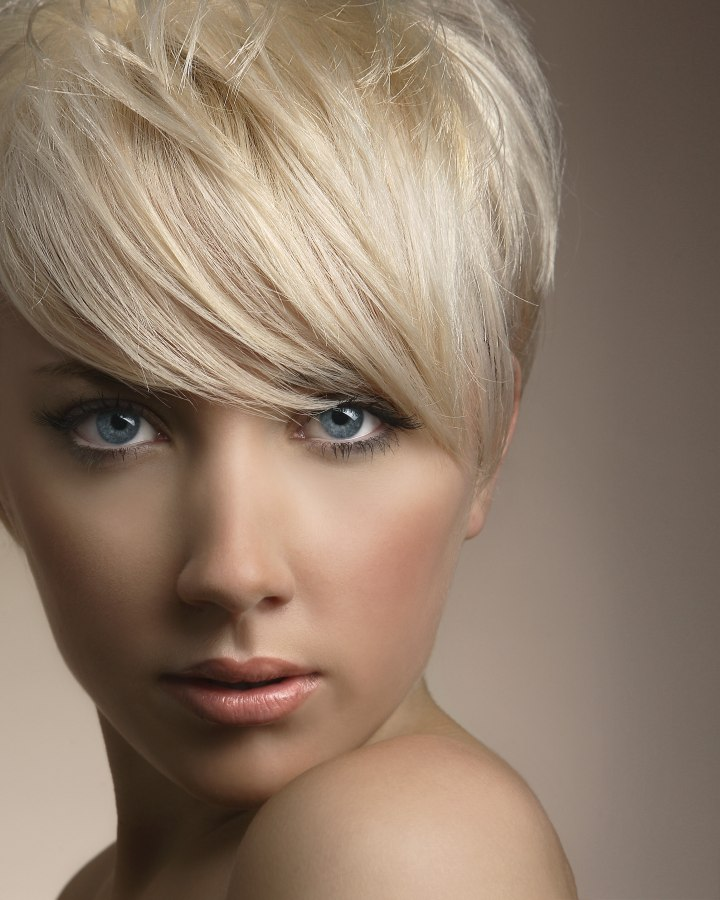 Short platinum blonde hair cut around the ears
