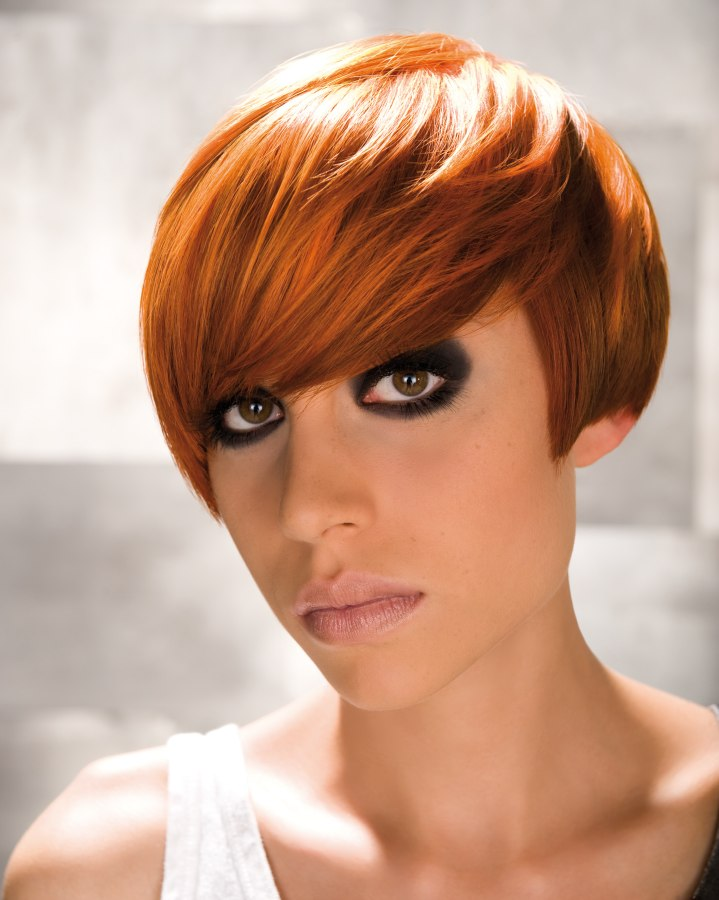 Short Hairstyle With The Hair Cut Just Above The Earlobe