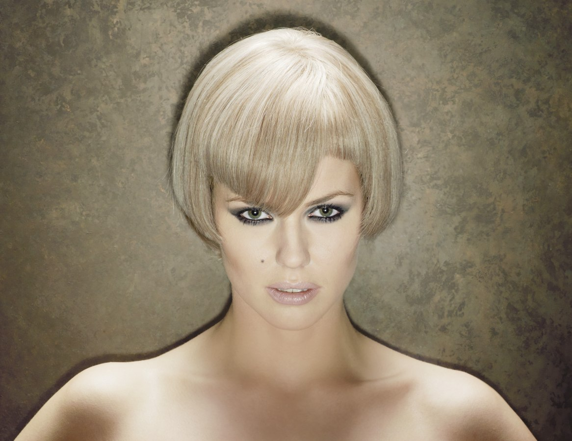 beveled bob haircut with a notch above the eye
