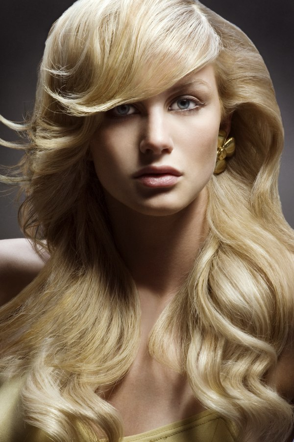 Long Flowing Blonde Hair Styled Into Smooth Cascading Waves