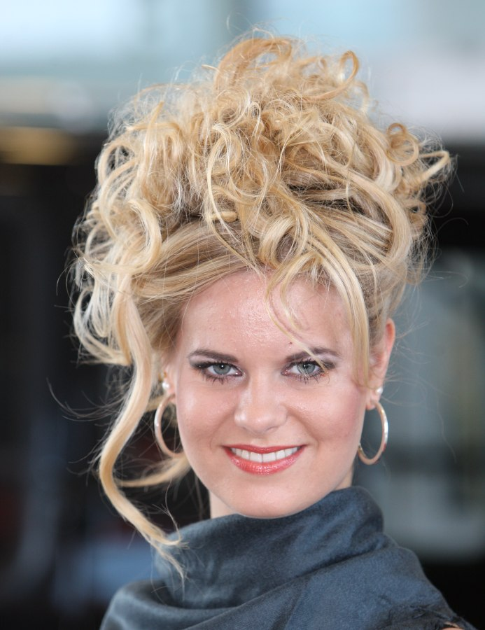 Deliberate Messy Updo With Curls And Free Spirited Tendrils