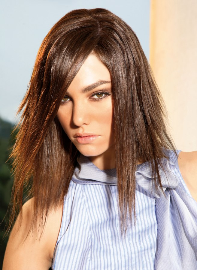 Shoulder-length hair, razor-cut and deeply layered for a ragged look