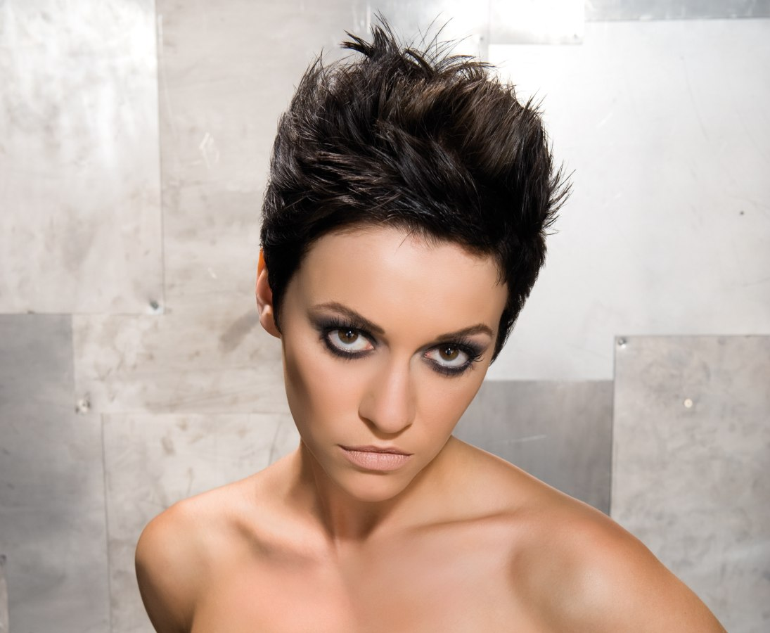 Spiky short hairstyle with close cropped sides for thick hair
