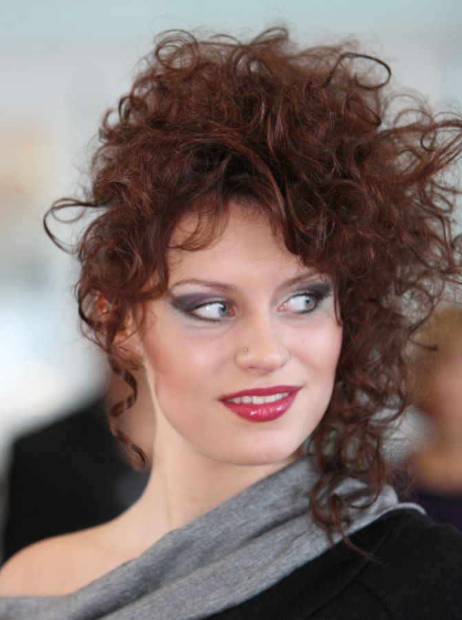 Updo With A Mass Of Curls Loosely Cascading Down On One