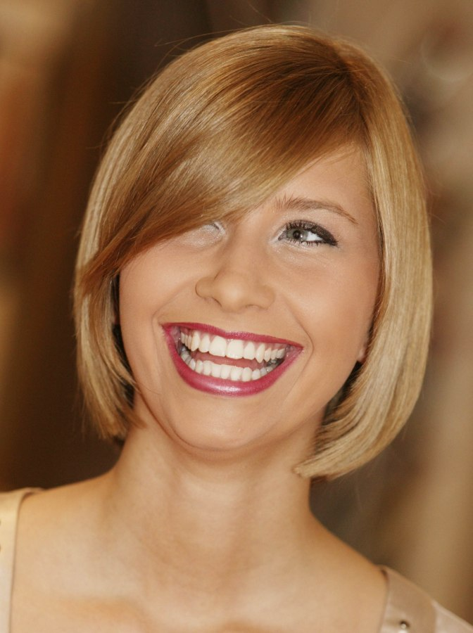 Blunt Cut Bob Hairstyle With A Curved Fringe And Hair That Moves Gently