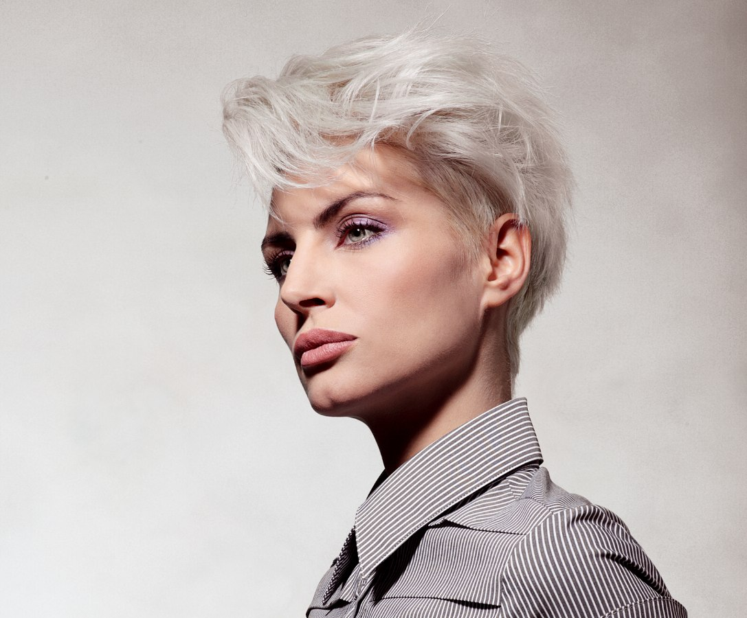Short Haircut With A Steeply Tapered Neckline For Grey Hair