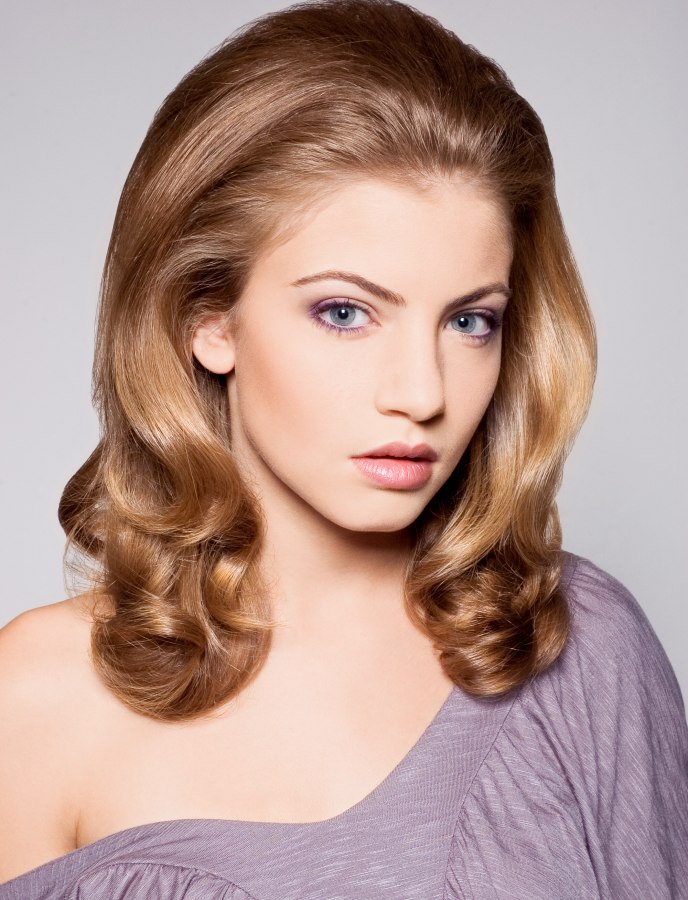 1960s inspired hairstyle with long flowing waves that curl ...