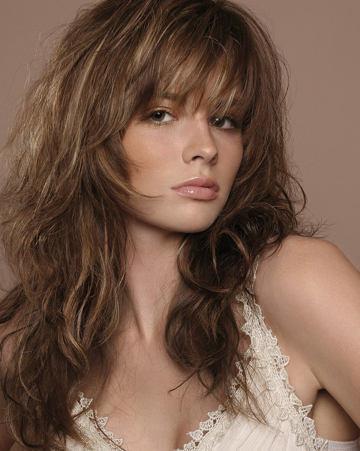 Long Layered Haircut With Highlights And Styled With Ruffing