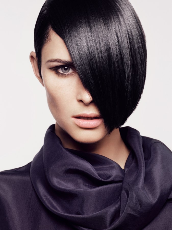 Chin Length Bob Hairstyle With One Side Tucked Behind The