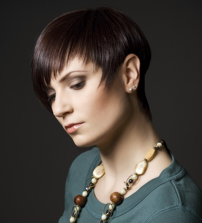 Pixie Style Haircut With Tapered Sides And A Curved Fringe
