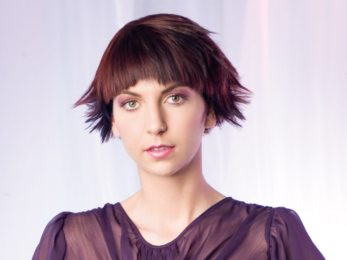 Short A Line Haircut With Curved Bangs