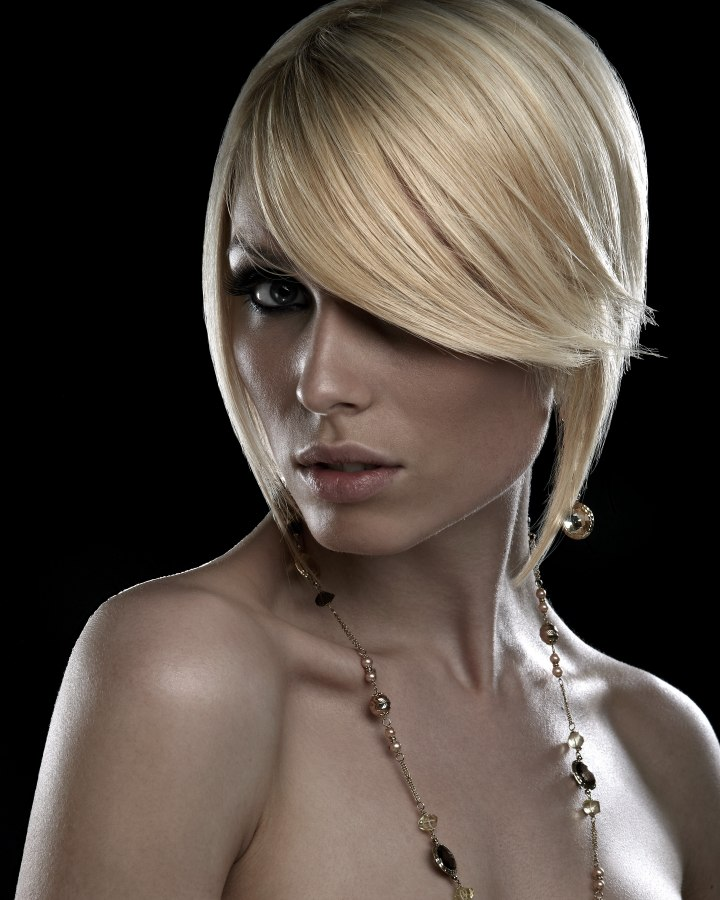 Steeply Angled Bob With A Long And Angle Cut Fringe And