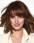 trendy haircut with thick bangs