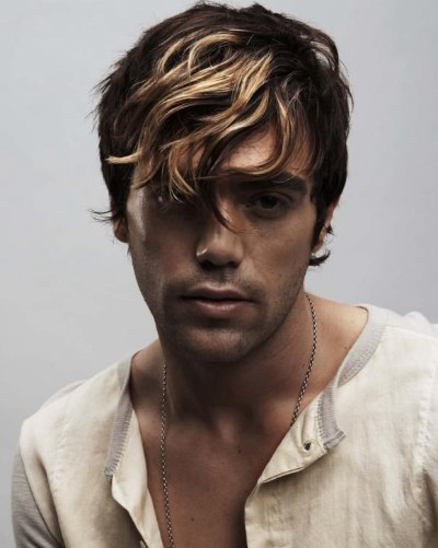 Men S Haircut With A Swirled Fringe And Highlights