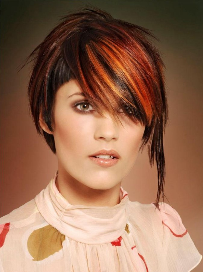 Short Hairstyle With An Undercut And Long Streaks Of Red Hair