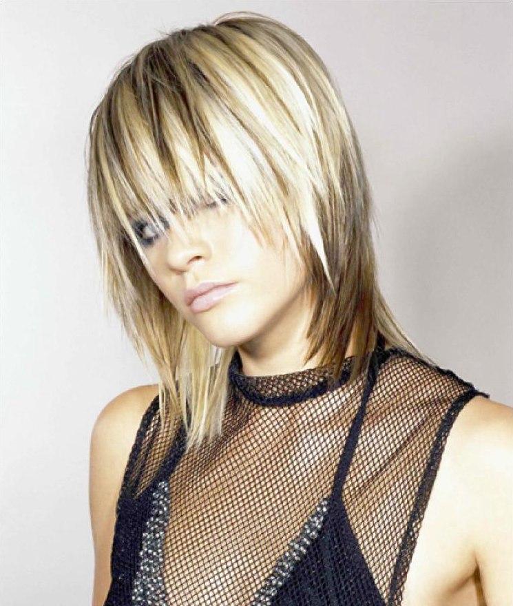 Blonde hair with dark streaks or lowlights