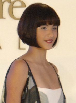 Inverted Bob Haircut Tossed And Nestled Waves And Curls