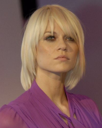 Platinum Blonde Hair Cut Below The Collar And With Angles