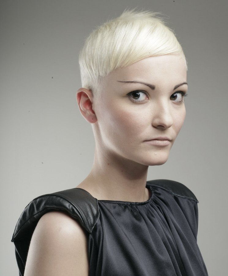 Short haircut with a strong sculpted shape and a white ...
