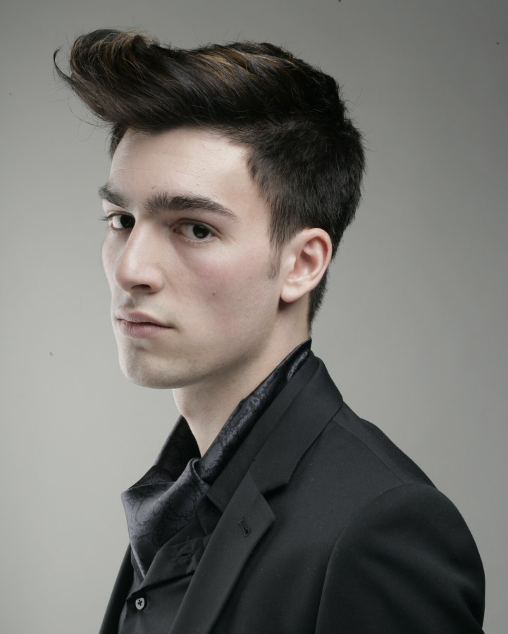 Men S Hairstyle With Short Sides And A Windblown Effect