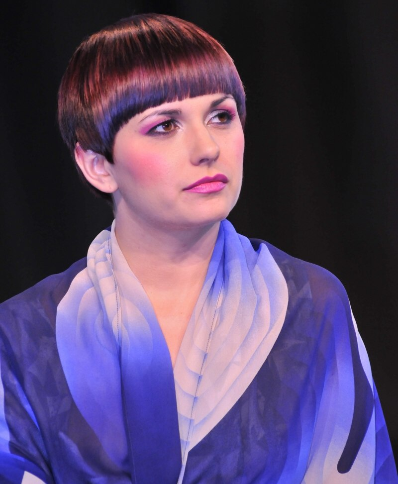 Expressive Short Hair Cut With A Sleek Fringe And Layered Sides
