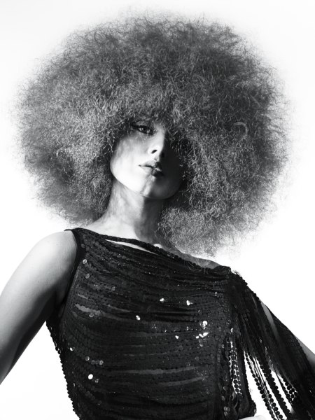 very curly 70s afro hairstyle