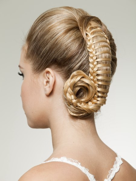 updo with woven hair gathered to the center of the crown