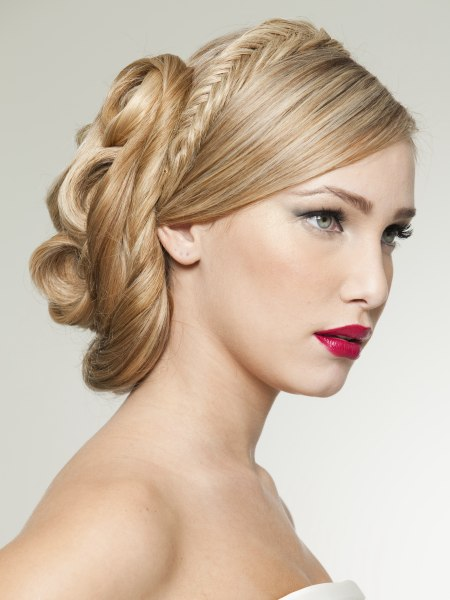 updo with a herringbone braid and an elongated bun