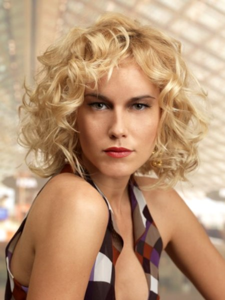 short blonde hairstyle with large curls