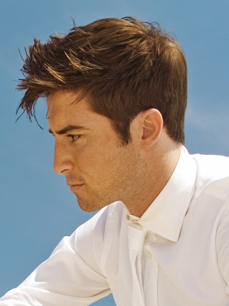 neat men's hairstyle with a long fringe