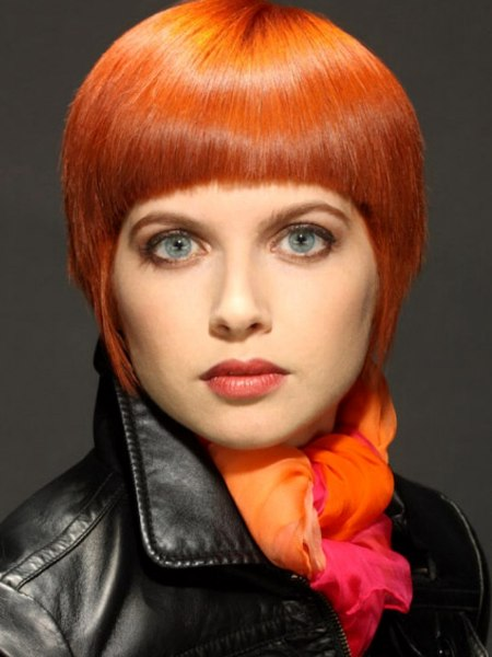 Short orange hair styled sleek
