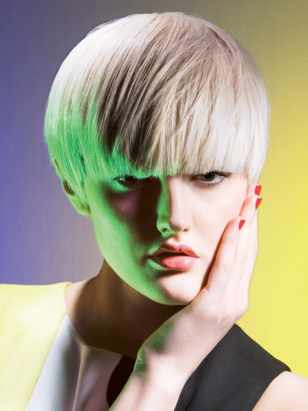 blonde bowl cut with an ear to ear cutting line