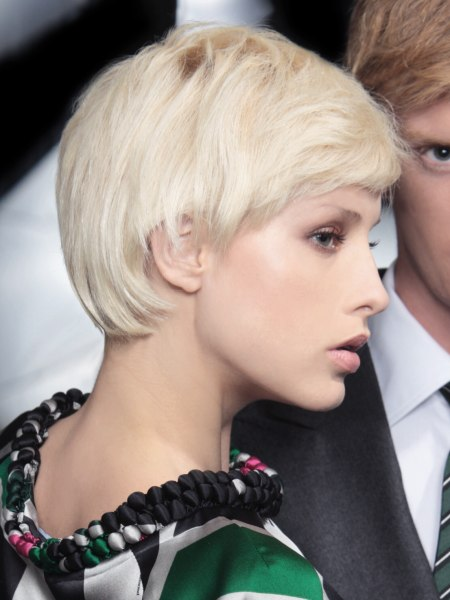 short blonde haircut with layers and a round nape