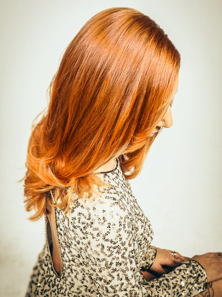 Long and sleek red hair