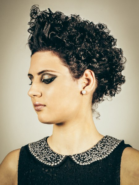 Short hair with shimmery gel styled curls