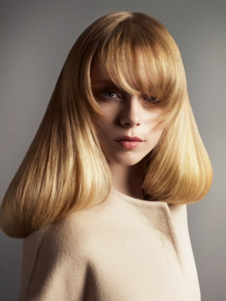 long blonde hairtstyle with tapered bangs