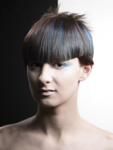 short geometric hair style with blunt cut bangs