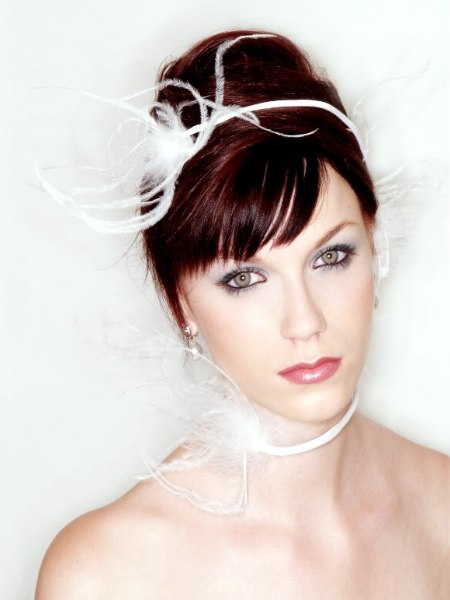Turban up-do wedding hair with a feathered ribbon