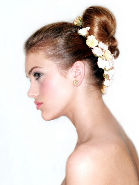 Hair styled in a bun with flowers