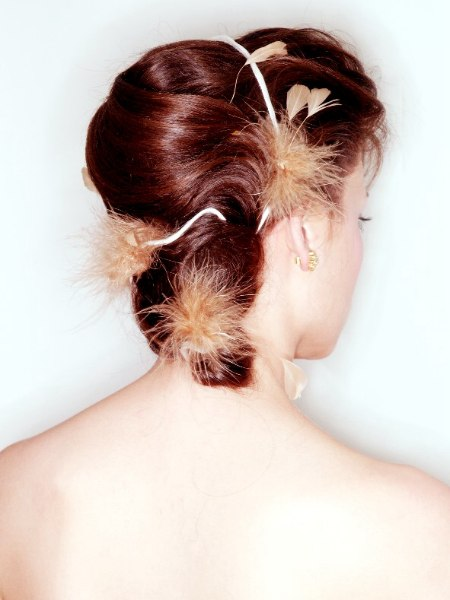 Up-do with a banana bun on the back of the head