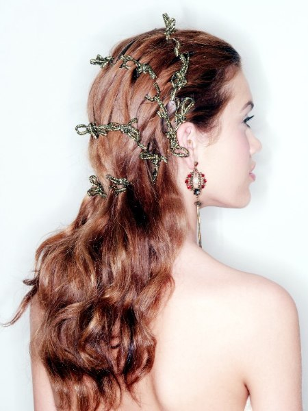 Long festive hairstyle with interwoven ribbons
