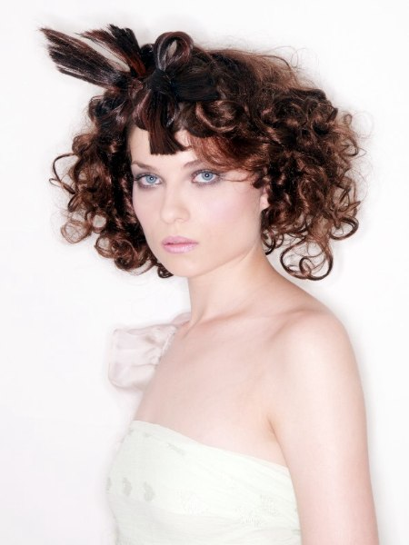 Romantic hairstyle with curls and a bow hairpiece