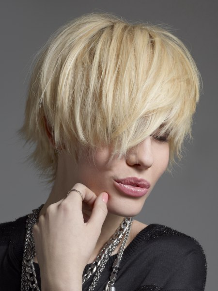 Rough short haircut with a long fringe