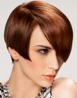 Short hairstyle with clean lines and long curved bangs