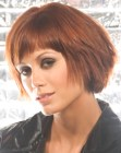 Textured bob with curved bangs and a longer back